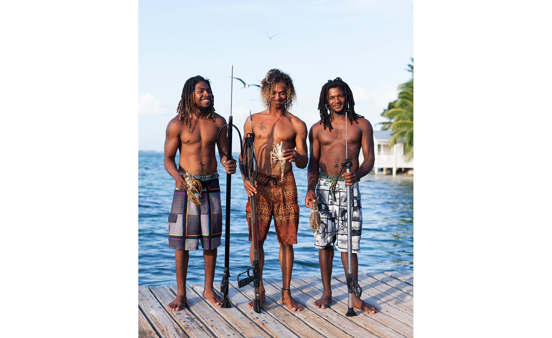 belize lobster rasta fisherman pier caye sailing raggamuffin
